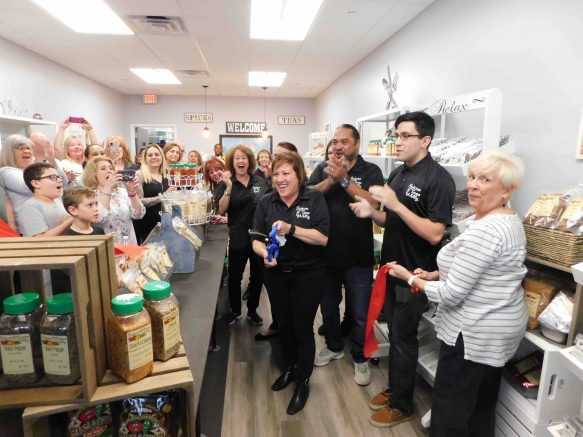 Milly Ferrer cuts the ribbon at her new store in the Southgate Plaza.