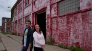 WEDI Executive Director Carolynn Welch and Community Development Director Bob Doyle outside new West Side Bazaar location.