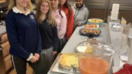 Students prepare dinner at Ronald McDonald House.