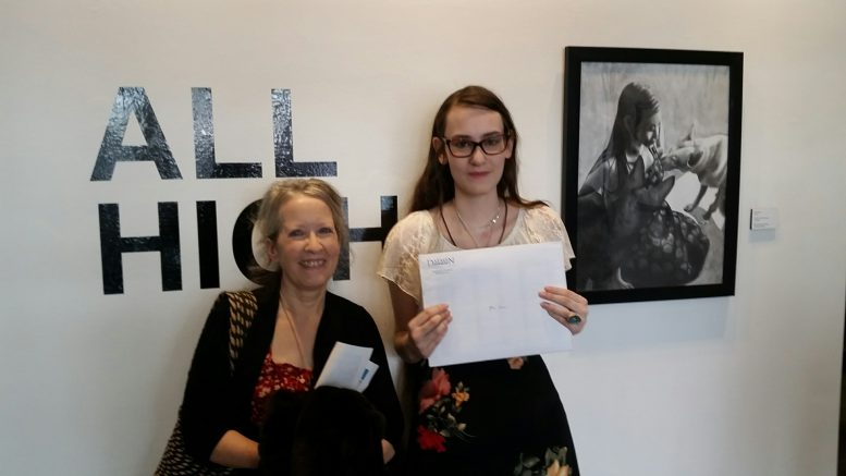 "Mia Mahar and her art teacher, Jacqueline Welch, with her ""Best in Show"" drawing."
