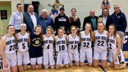 The Mt. Mercy basketball team with local honorees.
