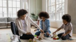 Extended time at home is an excellent opportunity for families to connect and play. © fizkes / iStock via Getty Images Plus