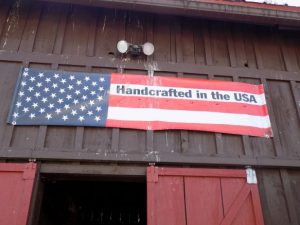 Sign atop the barn entrance.