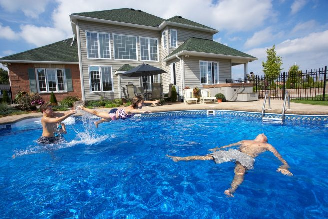 In addition to adult supervision, safety code compliance helps ensure a safer, more enjoyable pool experience. © Jupiterimages / iStock via Getty Images Plus